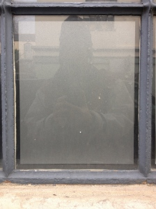 Brick Lane panelling with accidental self-portrait